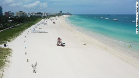 The shoreline in Miami Beach was barren after the city closed beaches for the holiday.