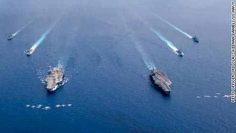 US planes fly in formation above the USS Nimitz and USS Ronald Reagan Carrier Strike Groups as they conduct dual carrier operations in the South China Sea.