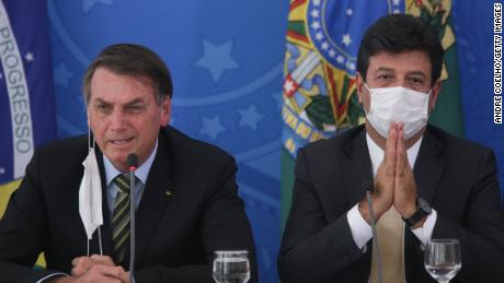 Former health minister Luiz Henrique Mandetta, at right in this photo from March, disagreed with President Jair Bolsonaro, left, over how to tackle the coronavirus pandemic.