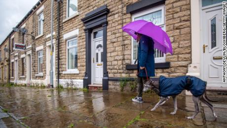 A pedestrian walks a dog along a street in Manchester on July 7.