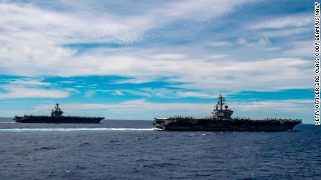 The aircraft carriers USS Nimitz and USS Ronald Reagan transit the South China Sea together last year.