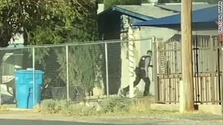 Police officer Joshua Gonzalez running toward the mobile home in Socorro.