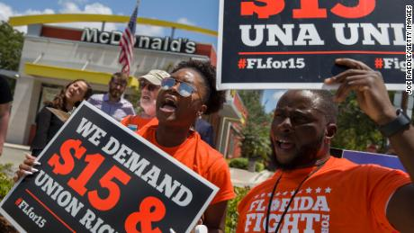 People gather to ask McDonald's to raise workers wages to a $15 minimum wage and demand the right to a union on May 23, 2019 in Fort Lauderdale, Florida.