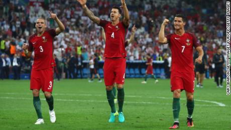 Pepe (left), Jose Fonte and Cristiano Ronaldo (right) celebrate victory over Poland in the quarterfinals of Euro 2016.