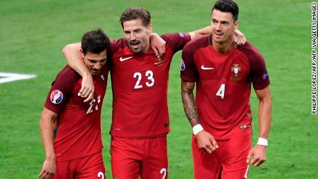 Cedric Soares (left), Adrien Silva and Jose Fonte celebrate victory against France in the Euro 2016 final.