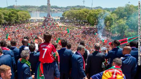 Portuguese players show the European Cup to supporters in Lisbon.