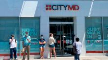 People form a line outside of the CityMD clinic in Forest Hills, Queens, New York.