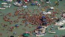 Hundreds of people gathered at Torch Lake, in the northwest corner of the Lower Peninsula in Michigan, over the July 4 weekend.