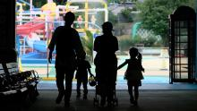 Parents and children enter a swimming pool open to a limited number of visitors as a preventive measure against coronavirus at Tokyo's Toshimaen amusement park on July 13.