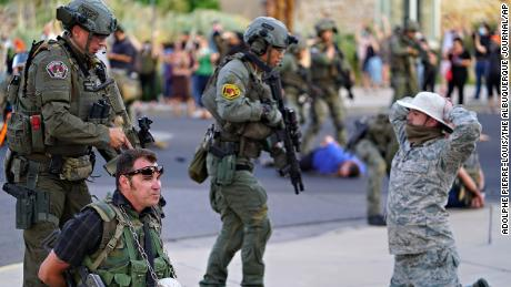 Albuquerque police detain members of the New Mexico Civil Guard last month in Albuquerque.