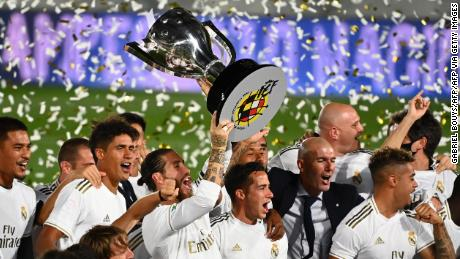 Real Madrid captain Sergio Ramos holds aloft La Liga trophy.