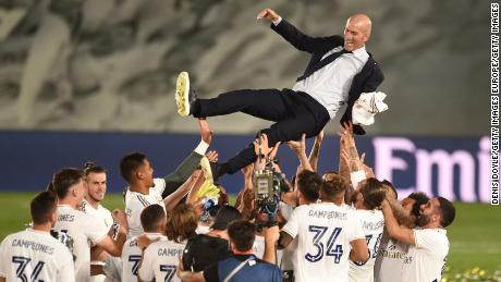 Real Madrid players celebrate with head coach Zinedine Zidane.