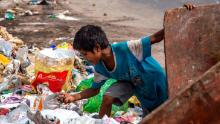 An Indian child ragpicker collects valuable waste items from a dumping site on July 15, 2020  in New Delhi, India.