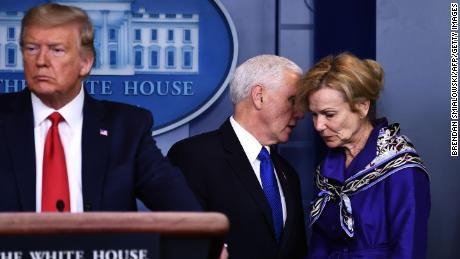 Dr. Birx listens to Vice President Mike Pence, during a briefing at the White House on March 18.