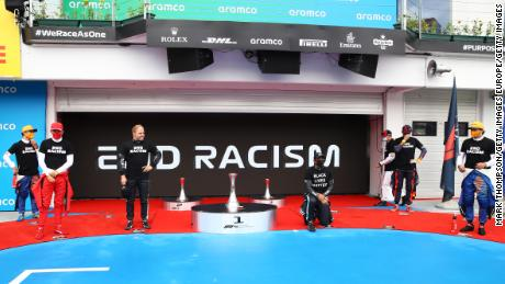 Lewis Hamilton takes a knee in support of the Black Lives Matter movement.