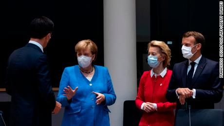 Netherlands' Prime Minister Mark Rutte, left, talks with Germany's Chancellor Angela Merkel, President of the European Commission Ursula von der Leyen and France's President Emmanuel Macron at the summit.