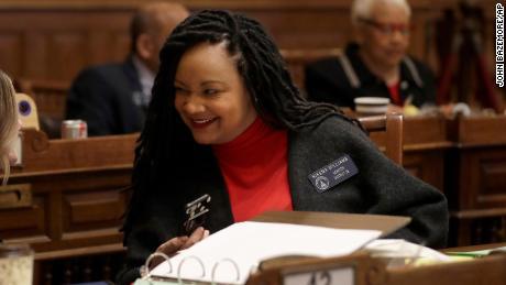 State Sen. Nikema Williams, an Atlanta area Democrat, talks to a colleague on the floor of the Georgia State Senate in February.