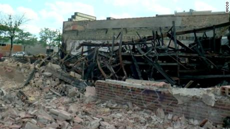 A body was discovered in the burned-out wreckage of Max It Pawn in Minneapolis, police said.