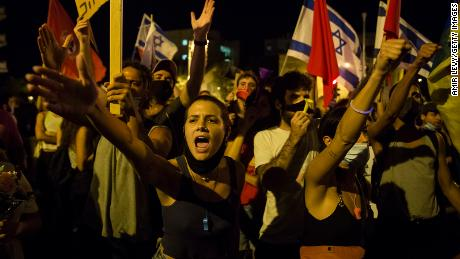 Crowds protest Netanyahu's handling of the pandemic in Jerualem in July.