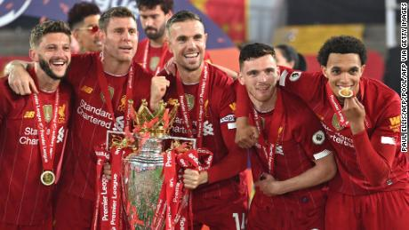 Liverpool players pose with the Premier League trophy during the presentation.