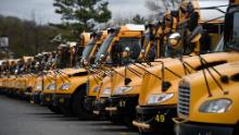About 100 school buses are parked at the Arlington County Bus Depot,  in response to the novel coronavirus, COVID-19 outbreak on March 31, 2020 in Arlington, Virginia. - Forty-seven states and the District of Columbia have decided to close schools in response to the coronavirus pandemic, affecting nearly 55 million students and seven US states have closed school for the remainder of the year, as the coronavirus outbreak continues to spread across the country. (Photo by Olivier DOULIERY / AFP) (Photo by OLIVIER DOULIERY/AFP via Getty Images)
