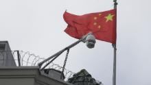 The flag of China flies behind a security camera over the Chinese Consulate in San Francisco, Thursday, July 23, 2020.