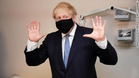Masks rule goes into effect in England as Boris Johnson calls anti-vaxxers 'nuts'