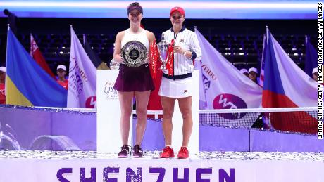 Champion Ashleigh Barty and Elina Svitolina pose with their trophies after the WTA Finals in 2019.