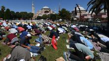 Men take part in Friday prayers outside Hagia Sophia in Istanbul on July 24, 2020.