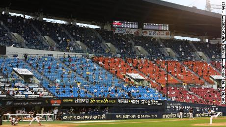 Baseball fans watch on from the stands during the KBO League game between LG Twins and Doosan Bears.