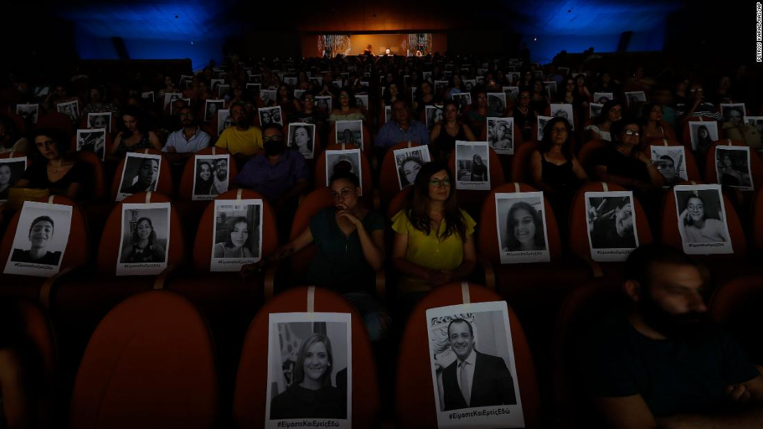 Portraits are taped onto seats to help theatergoers spread out in Nicosia, Cyprus, on July 27.