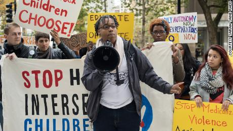 Intersex activist Sean Saifa Wall protests outside Lurie Children's Hospital in 2017.