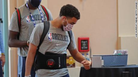 Tyus Jones #21 of the Memphis Grizzlies arrives during practice as part of the NBA restart 2020 on July 17, 2020 in Orlando, Florida.