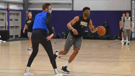 Giannis Antetokounmpo #34 of the Milwaukee Bucks dribbles the ball during practice as part of the NBA restart 2020 on July 27, 2020 in Orlando, Florida.