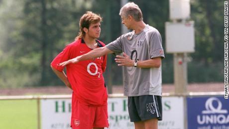 Fabregas talks to Arsenal manager Arsene Wenger during preseason training on July 24, 2004 in Bad Waltersdorf, Austria.