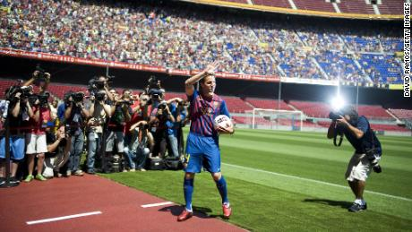 Fabregas gestures during his presentation as the new signing for FC Barcelona at Camp Nou sports complex on August 15, 2011 in Barcelona, Spain.