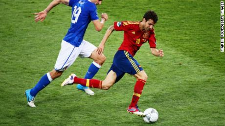 Fabregas (R) runs with the ball past Leonardo Bonucci of Italy during the UEFA EURO 2012 final match between Spain and Italy at the Olympic Stadium on July 1, 2012 in Kiev, Ukraine.