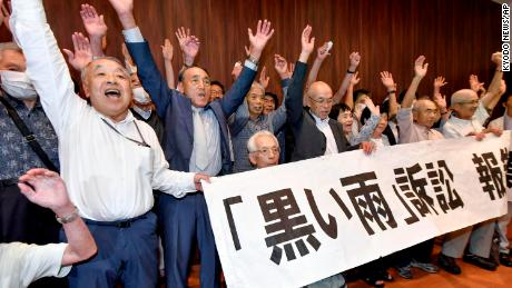 A group of plaintiffs and supporters celebrate after the Hiroshima court ruling on July 29, 2020.
