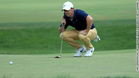 McIlroy lines up a putt on the seventh green during the second round of The Memorial Tournament.