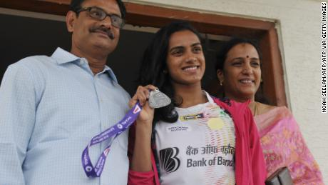 'Your rock and pillars': Sindhu with her father Ramana (L) and mother Vijaya (R) who have played a central role in her upward trajectory
