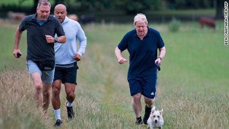 British Prime Minister Boris Johnson is seen jogging on July 29.