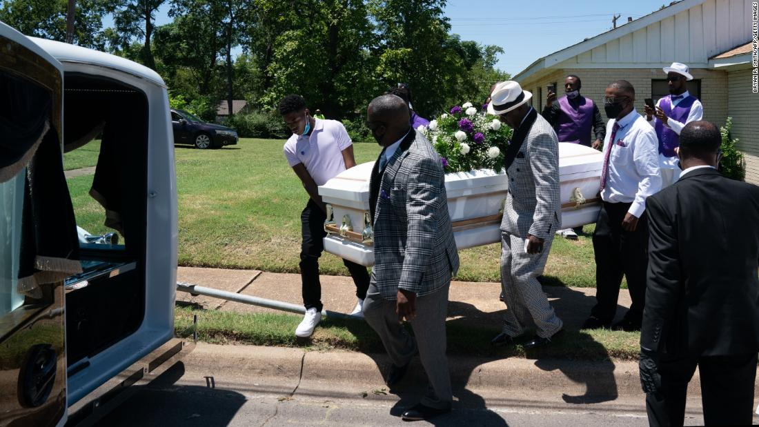 A casket carrying the body of coronavirus victim Lola M. Simmons is placed into a hearse following her funeral service in Dallas on July 30.