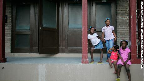 Sisters Corlia, Kayla, Aaliyah and Kaylen Smith stand on their front porch at the B.W. Cooper housing project in New Orleans.