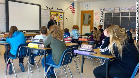 A principal talks to 8th-graders about school safety in Wellsville, New York. Many public schools in the US remain largely segregated.
