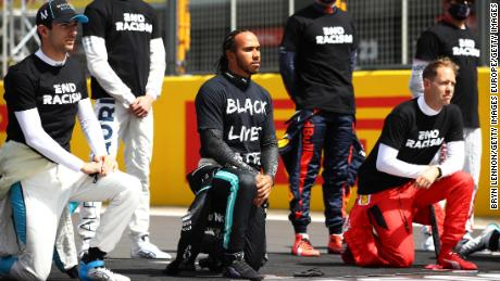 Lewis Hamilton takes a knee on the grid in support of the Black Lives Matter movement.