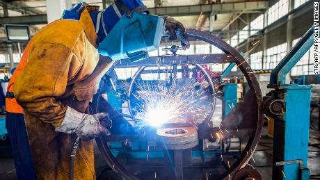China's factory output grows at strongest pace in nearly decade. But weak spots remain