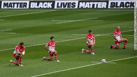 St Helens players take a knee before Sunday's game.