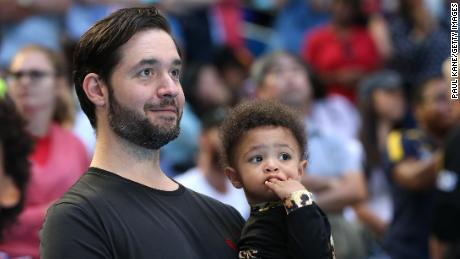 Ohanian holds Olympia while watching Williams at the Hopman Cup in 2019.