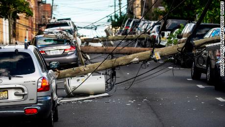 Utility poles were felled Tuesday by Tropical Storm Isaias as it hit Guttenberg, New Jersey.