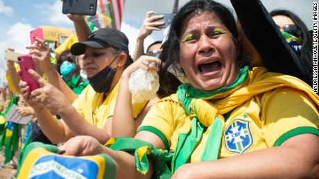 A supporter of Brazilian President Jair Bolsonaro cries during a demonstration in favor of his government amidst the coronavirus pandemic in front of Planalto Palace on May 24, 2020 in Brasilia, Brazil.